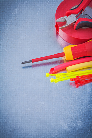 cable tie: Insulating tape electric wires cable ties screwdriver nippers construction concept.