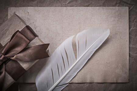 giftbox: Giftbox sheet of wrapping paper quill holidays concept.