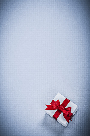 wrapped present: Wrapped present box on white background holidays concept.