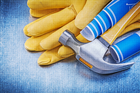 claw hammer: Safety gloves blue rolled blueprints claw hammer.