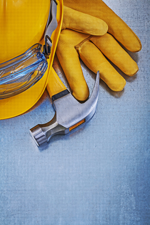 protective eyewear: Protective eyewear building helmet leather gloves claw hammer construction concept.