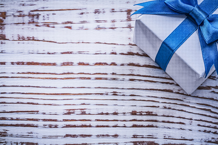 wrapped present: Wrapped present box on vintage wooden board holidays concept. Stock Photo