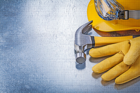 protective eyewear: Protective eyewear hard hat safety gloves claw hammer construction concept.