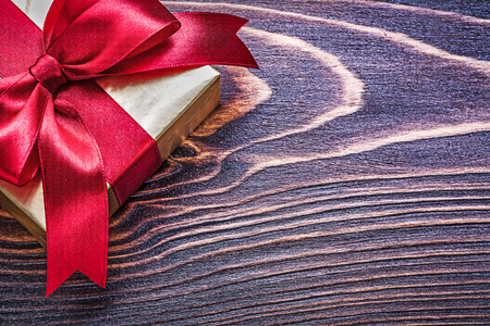 glittery: Present box wrapped in glittery paper on wooden board. Stock Photo
