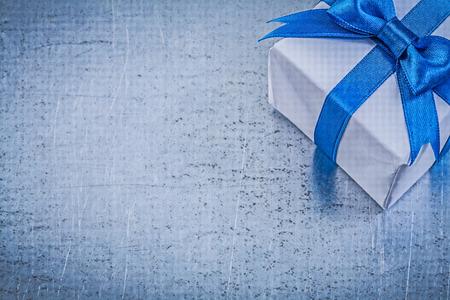 giftbox: Giftbox on metallic background holidays concept.