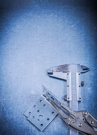 bar tool set: Adjustable pliers wrench slide caliper angle bracket on metallic background. Stock Photo