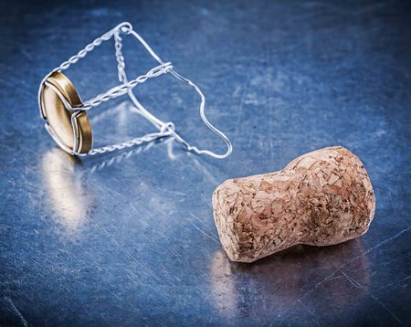 stopper: Cork stopper with twisted wire on metallic background. Stock Photo