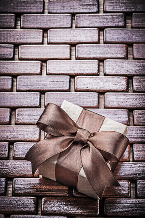 matting: Packed present box on wooden wicker matting holidays concept.