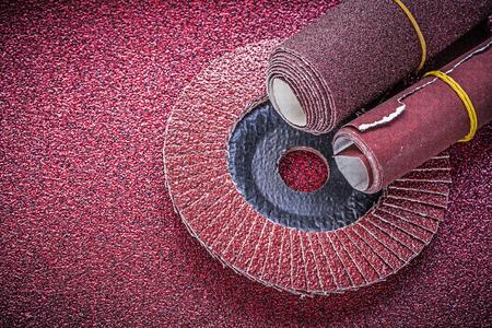 flap: Rolled sandpaper flap grinding wheel on abrasive sheet. Stock Photo