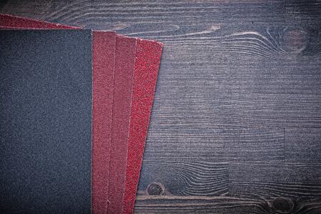 emery paper: Abrasive paper on vintage wooden board.