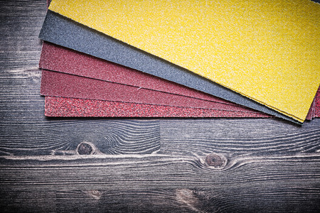 emery paper: Glass-paper on vintage wooden board abrasive materials.