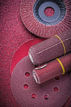 emery paper: Abrasive flap wheels grinding discs emery paper rolls. Stock Photo