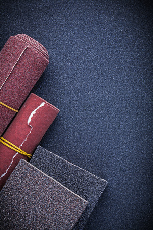 emery paper: Composition of abrasive sponges polishing paper rolls. Stock Photo
