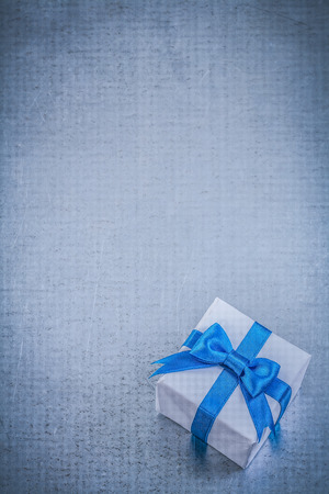 giftbox: Giftbox blue bow on metallic background copy space holidays concept. Stock Photo