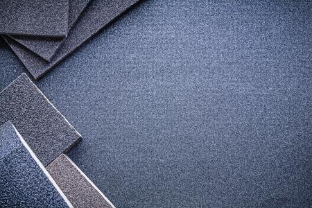 emery paper: Abrasive sponges on sandpaper copy space.