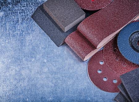 emery paper: Set of abrasive tools on metallic background horizontal view. Stock Photo