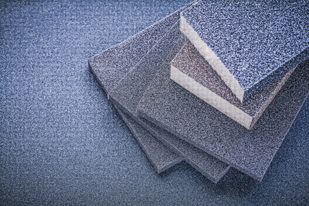 emery paper: Abrasive sponges for grinding on emery paper top view. Stock Photo