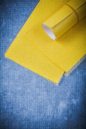 sandpaper: Yellow sandpaper on metallic background abrasive tools. Stock Photo