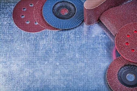 emery paper: Polishing paper grinding discs abrasive flap wheels on metallic background. Stock Photo
