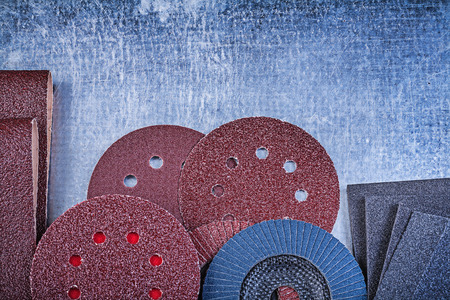 buffing: Collection of abrasive tools on metallic background top view. Stock Photo