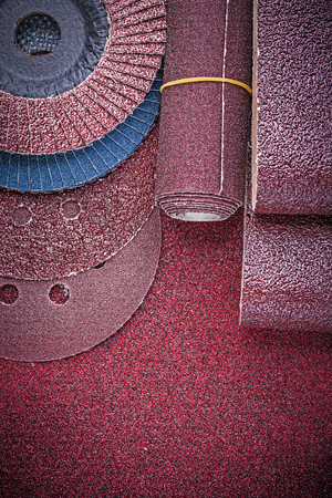emery paper: Collection of abrasive equipment on polishing paper sheet. Stock Photo