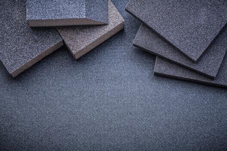 abrasive: Abrasive sponges on polishing sheet horizontal view.