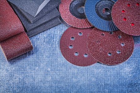 Composition of abrasive equipment on metallic background directly above.