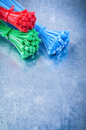 cable tie: Vertical version of cable ties on metallic background construction concept. Stock Photo