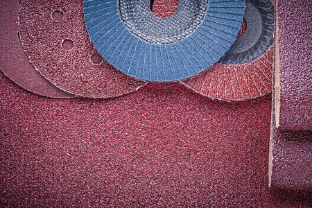 emery paper: Rolled glass-paper abrasive wheels on polishing sheet.