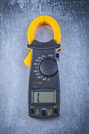 ammeter: Digital ammeter on metallic background. Stock Photo