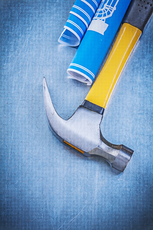 claw hammer: Blue engineering drawings claw hammer on metallic background.