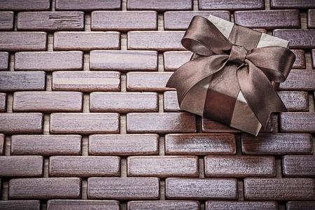 matting: Present box on wooden wicker matting holidays concept.