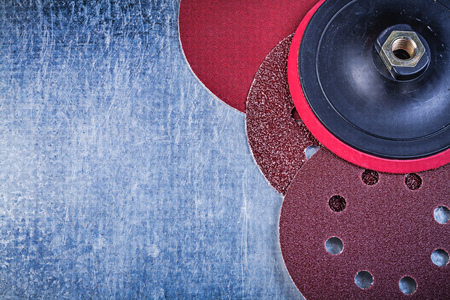 abrasive: Grinding discs holder on metallic background abrasive materials. Stock Photo