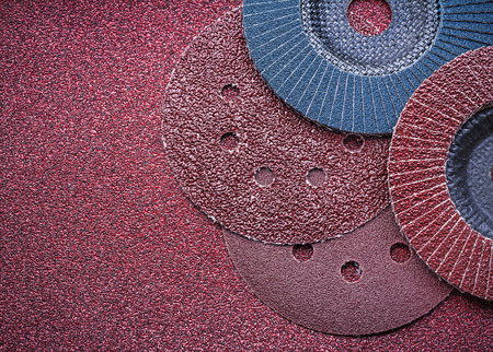 emery paper: Abrasive discs flap grinding wheels on glass-paper close up view.