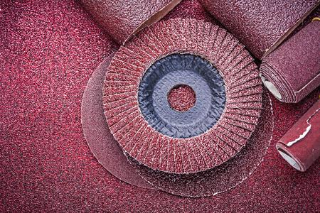 emery paper: Rolled sandpaper abrasive discs on polishing sheet.