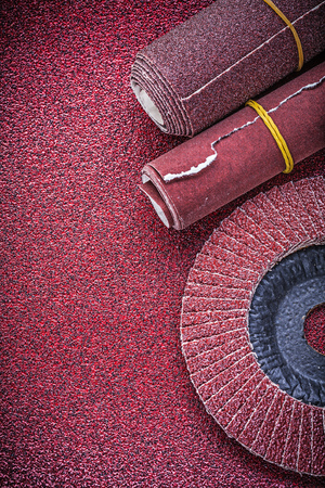 emery paper: Rolled emery paper flap grinding wheel on abrasive sheet.