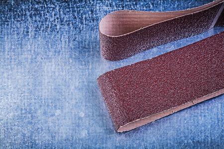 emery paper: Sandpaper on scratched metallic background abrasive materials.