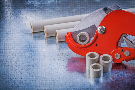 waterpipe: Water pipe cutter on metallic background construction concept.