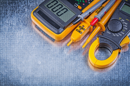ammeter: Digital ammeter electrical tester multimeter on metallic background. Stock Photo