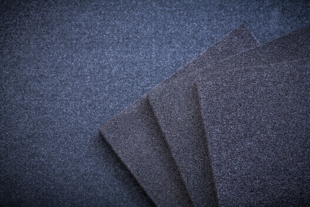 emery paper: Sanding sponges on glass-paper abrasive tools.