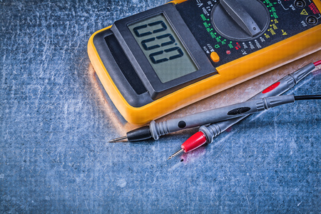 electric current: Digital electric tester current probe on metallic background.