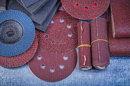 emery paper: Collection of abrasive materials on metallic background close up view.