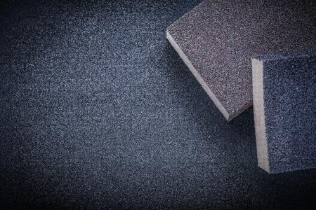 emery paper: Abrasive sponges on emery paper.