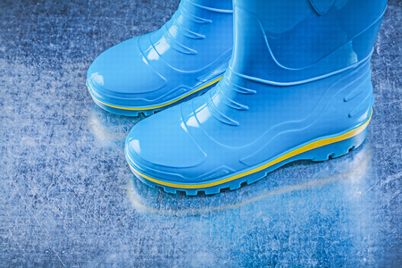 gum boots: Pair of safety gumboots on metallic background.