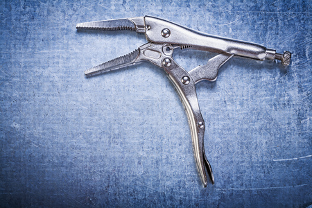 fix jaw: Adjustable pliers wrench on metallic background construction concept.
