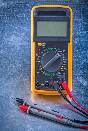 dielectric: Digital multimeter on metallic background electricity concept.