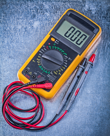 the tester: Digital electrical tester on metallic background.