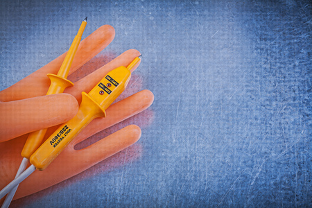 dielectric: Dielectric rubber gloves electrical tester on metallic background.