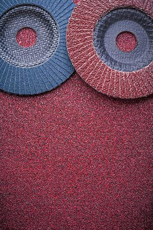 abrasive: Abrasive flap wheels on sandpaper top view.