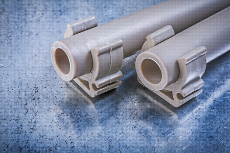 stainless steel range: Water-pipes pipe clamps on metallic background construction concept. Stock Photo